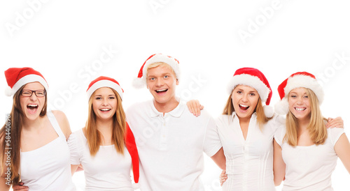 A group of happy teenagers posing in Christmas hats