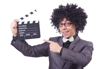 Man with movie clapper isolated on white
