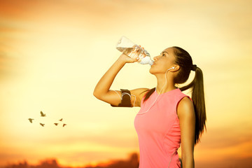 Female jogger drinking water