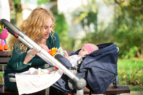 Mother with baby in pram