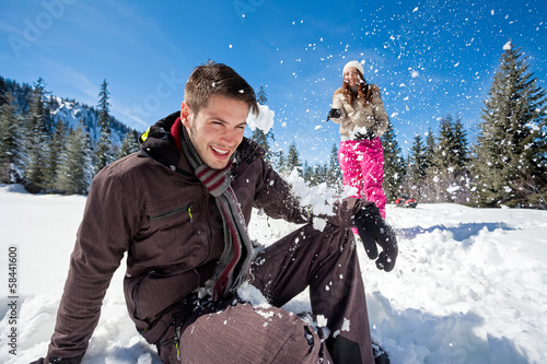 Winter couple snowball fight
