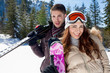 Happy couple with skis
