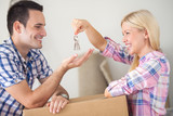 Fototapety Couple with the keys to their new home