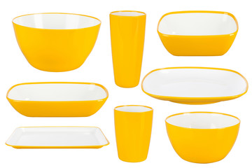 Yellow plastic dishes on white background