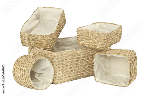 Various braided bamboo baskets on white