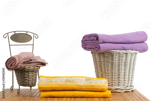 Wicker baskets full of clean colored towels