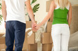 Couple moving into a new house and holding hands