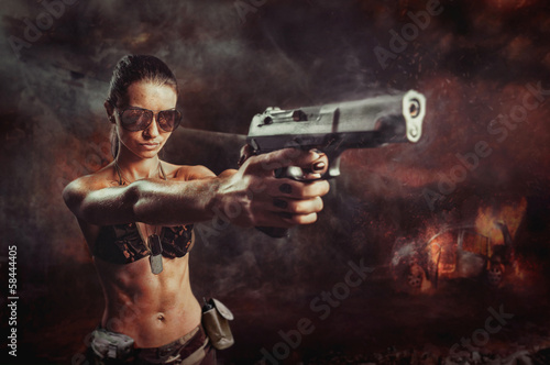riot girl aiming a gun close up