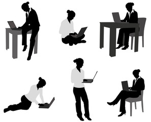 woman working on her laptop silhouettes - vector