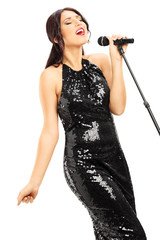 Young woman in black dress singing