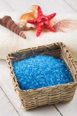 Sea salt in bucket on wooden background