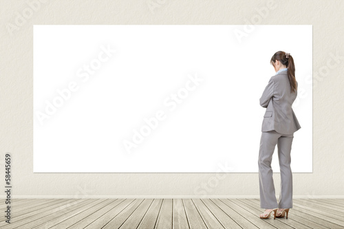 Asian business woman looking at blank banner