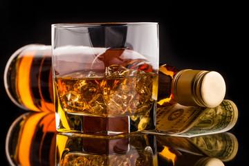 money and whisky bottle