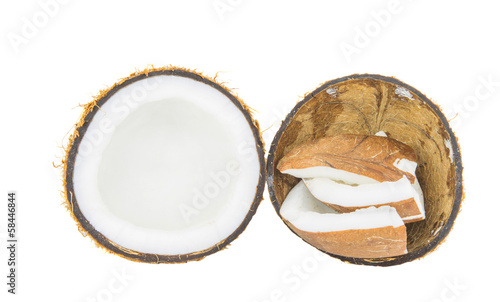 Coconut shell and coconut flesh over white background