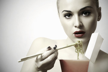 beautiful woman are eating.red lips.Chinese sticks.food