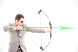 Determined businessman aiming at target, bow and arrow