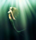 beautiful woman mermaid with fish tail