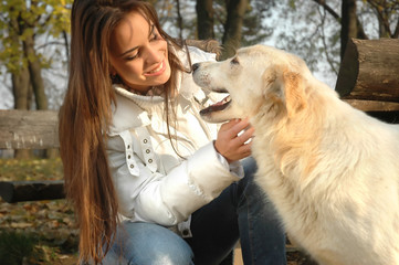 beautiful young woman with white dog