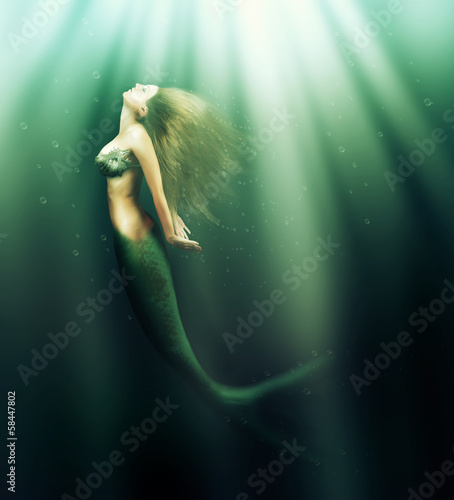 beautiful woman mermaid with fish tail