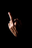 Middle finger on black background