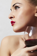Beautiful blond woman with wineglass.red lips.dry red wine