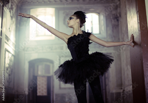 Staande foto Foto van de dag Black swan ballet dancer in move