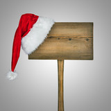 wooden road sign with Santa  hat