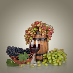 barrel, bottles, grapes and glass of wine