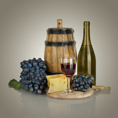 bottle, glass of wine,  ripe grapes and cheese