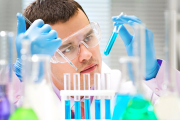 Researcher working with chemicals