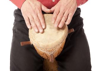 Man playing African drum on his lap