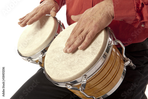 Man playing bongo set on his lap