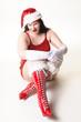 Sexy Weihnachtsfrau hockend