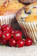 Red currant muffin on linen background