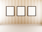 empty pictureframes on wall