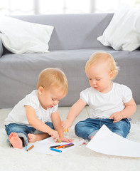 babies draw with crayons at home