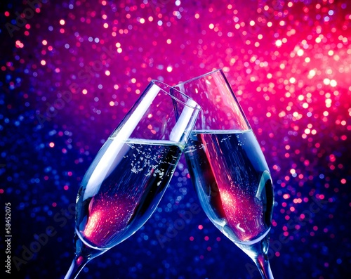 champagne flutes with bubbles on blue tint light bokeh - 58452075