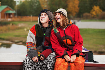 Young hippie couple in autumn park