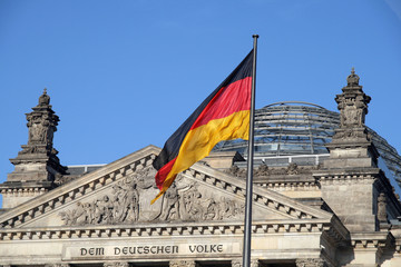Swinging German flag with Bundestag at the background