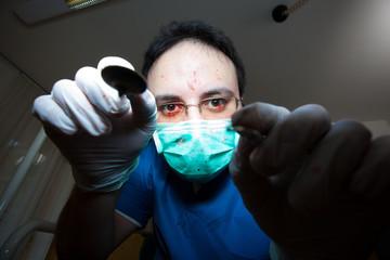 Crazy sadist dentist torturing a patient