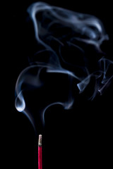 smoke from the incense stick on black background