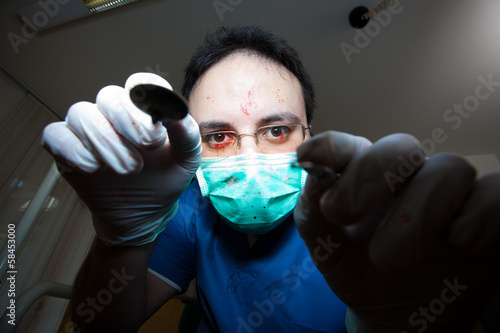 Crazy sadist dentist torturing a patient