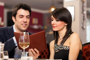 Couple reading a menu