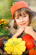 Girl in autumn clothes with pumpkins