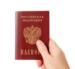 Russian passport in the hand isolated on white background