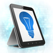 Finance concept: Light Bulb on tablet pc computer