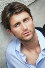 handsome young man wit green eyes