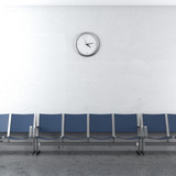wall clock and blue seats