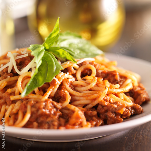 canvas print picture spaghetti dinner with meat sauce and basil