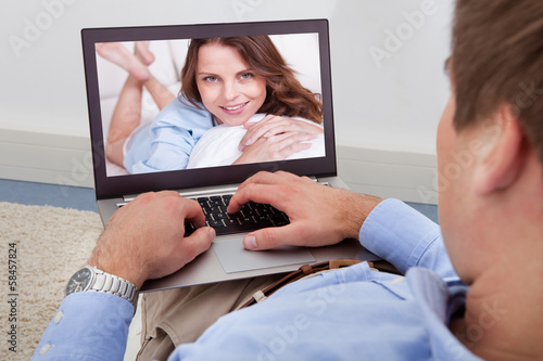 Man Video Chatting On Laptop